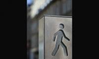 The monoliths also feature a pedestrian logo.