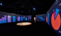 The animated infographics fill the walls of the installation at the London Design Biennale.