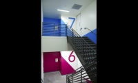 Sky Design made strategic use of stairwells for floor numbering, and included room directories outside each door.