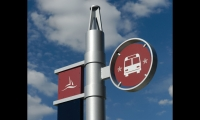 Branded transit signs feature a buoy-inspired pole and National Harbor's signature colors and logo.