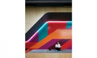 Throughout the renovated space, each graphic application aims to draw visitors and residents in