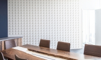 """Casts of cow tags and """"spilled milk"""" on the meeting room table."""