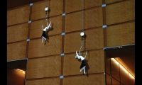 Computer-generated imagery includes silk-rope acrobats.