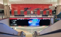At Tampa International, a hybrid blend of visual and virtual information for arriving passengers as they transition from the transfer level to the baggage claim level.
