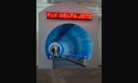 Lorenc+Yoo master planned the visitor flow into the space, developed the exhibits' storylines, and populated the space with historic Delta aircraft. Here, a dramatic tunnel space is anchored by a spinning jet engine.