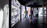 Unfolding over two stories and 18,000-squarefeet, guests follow a bicycle path through the multi-sensory installation which features largescale reproductions of Cunningham's most iconic photos, video and audio interviews. Photo credit: Sean Airhart/NBBJ