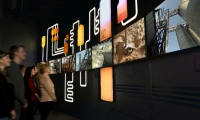 An array of digital displays provides an overview of the company and the spirits industry.