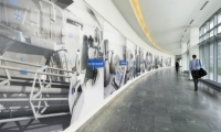 Corridor graphics reinforce the company's history, mission, and strengths.