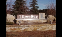 The monument sign and wayfinding system for T.Rowe Price's campus expansion used locally sourced stone, stainless steel, and a modular component system. Signs were sited to capitalize on existing lighting. (Photo: Harry Spetnagel/Gensler)