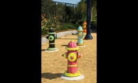 Designers realized that families would also want to bring their dogs to the park.  A garden of colorful fire hydrants was planted to entice dogs and help preserve landscaping.