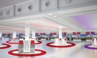 Holmes Wood also recommended bold floor graphics, including concentric circles that create color-coded exclusion zones around check-in kiosks.