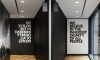 """We Believe in the Inherent Dignity of All People"" murals frame the café."