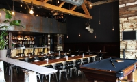 Grim's is a multi-level bar, with great drink specials. (Photo: Grim's Provisions & Spirits)