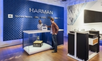A brand wall in Harman's signature blue emphasizes the store's diverse product lines.
