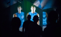 When the lights come back on, Olympic swimmer Michael Phelps beckons visitors into a cavernous theater space.