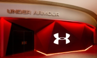 Unlike the traditional glass-fronted mall store, Under Armour has an enigmatic, closed-off, angular entrance.