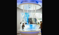 The Sound Spider is a circular console with touchscreens that allow shoppers to test headphones by selecting from a curated music library.