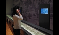 The exhibit includes four Energy Star-rated LCD flat screens that allow visitors to explore the intricacies of the large scrolls and learn about the art of calligraphy. The case shown here displays nearly all of a 50-ft.-long scroll, requiring 3x12-ft. lengths of acrylic.