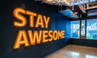 "The vintage-marquee-inspired ""Stay Awesome"" was rendered in a more contemporary interpretation."