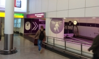 At Heathrow, color-coding is consistent from the website to the airport environment.