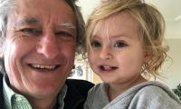Robert with his grandchild