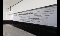 "The 12- by 2.5-meter ""Welcome to Vienna"" sign is digitally printed with the welcoming phrase in 30 different languages—a nod to the central European countries the Skylink terminal serves."