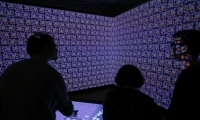 In the Immersion Room, the museum's wallpaper collection comes to life. Visitors access 10,000+ patterns and create their own designs, which are then projected on the walls.