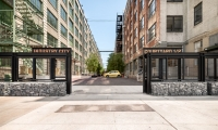 The gates off of 2nd avenue into courtyard 1/2 show the stenciled typeface chosen for the project.