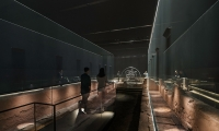 Visitors flow from the staircase into the mezzanine-level exhibit, which contains the bulk of the scholarly materials.