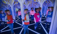 At the center of the space, a mind-bending 1,800-sq.-ft. mirror maze allows museum guests to step inside a tessellation pattern.