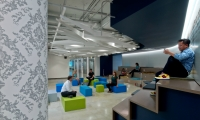 LinkedIn's Chicago office features custom wallpaper (left) designed by IA Interior Architects that at first glance looks like a traditional damask pattern found in many historic Chicago buildings.