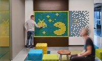 At LinkedIn San Francisco, interactive installations such as this pixel wall invite users to relax, connect, and create their own artistic expression.