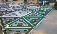 The touring version was built on identical triangular interlocking platforms that hold the maze together as well as contain the floor lighting and electrical componentry.