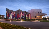 At dusk, the dichroic glass becomes semi-transparent, changing dynamically from red to blue on the exterior