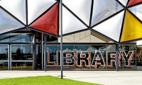 BrandCulture was brought on to design a wayfinding system including pictograms, signage and directories with a specific goal of linking the Oran Park Library to the site's past use. (image: building signage)