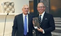 SVA President David Rhodes presents Bierut with the Masters Series Award. (Photo: Federico Rodriguez Caldentey)