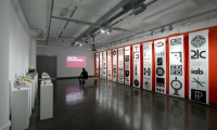 In Gallery Four, which focuses on Bierut's brand identity work, logos and symbols are displayed on giant reams of paper. (Photo: Bilyana Dimitrova)