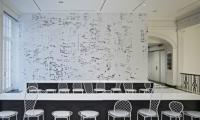 A famous NYC skyline photo was pixelated and reverse-printed on vinyl as the cafe's hero shot.