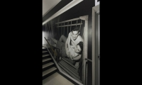 One of the photos is a famous shot of a couple on a fire escape, taken by Stanley Kubrick.