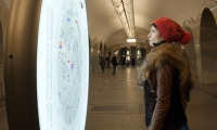 Freestanding circular totem with pedestrian orientation map, Kuznetsky Most Metro Station.