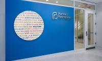 Clients' first view of the new Planned Parenthood of New York City in Queens is the Welcome Wall.
