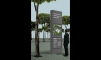 (2008) This rendering shows our early iteration of monolithic kiosks for the memorial plaza. It incorporated a digital clock that would subtly acknowledge the times of tower impacts. The LED screen would stream live content and real-time visitor information.