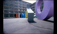 (1983) Pierluigi Cerri's visual identity for the Turin Lingotto used sculptural form as placemaking element. His colorful, monolithic letters were a perfect foil to the industrial aesthetic of the former Fiat car factory. (Photo: Gregotti Associati International srl)