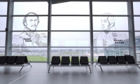 At a closer glance, the oversized portraits of Mikhail Kutuzov and Platov on the airport's windows are more than just historical faces.