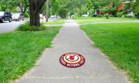 The DORA boundaries are proposed to be marked with sidewalk graphics to mitigate the visual pollution caused by additional signs at each intersection.