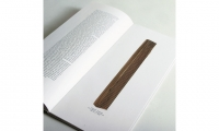 Studio Sonda (Porec, Croatia): This format is enhanced and strengthened by a textural wood detail used on the cover with its grain oriented on the same vertical axis as the book, as well as the use of a singular column of justified typographic text.
