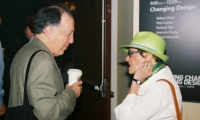 Same conference, different fabulous hat. Sussman chats with fellow SEGD Fellow Lance Wyman.