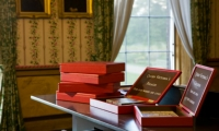 Reproduction despatch boxes in red leather with silkscreened text hold interactive games and puzzles that teach visitors about life in the Victorian era.