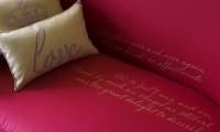 """OPERA collaborated with the charity Fine Cell Work; 17 prisoners in four different facilities embroidered the cushions for the """"Falling in Love"""" room. Each consists of 11,000 stitches featuring words and imagery symbolic of the royal couple."""
