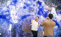"""The """"Gatorade Wall,"""" that captures an iconic moment of a victory celebration and allows visitors to be able to insert themselves into the action."""
